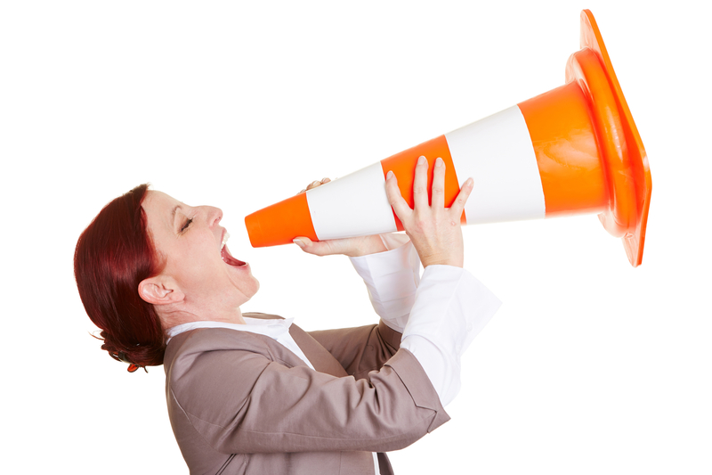 http://www.dreamstime.com/royalty-free-stock-image-angry-business-woman-shouting-big-traffic-cone-image30282626