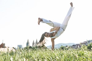 http://www.dreamstime.com/royalty-free-stock-photography-capoeira-woman-awesome-stunts-outdoors-image42091617